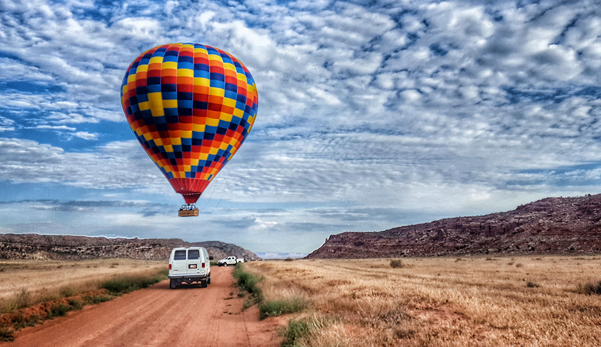 Van following balloon through canyonlands